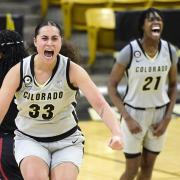 Colorado's Peanut Tuitele, center, and Mya Hollingshed celebrate a 77-72 win over Stanford on Jan. 17, 2021. (Photo by Cliff Grassmick)
