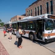 students wait to board Buff Bus