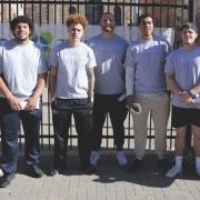 Colorado football team members outside Balch Fieldhouse