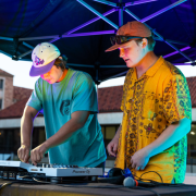 Two people mixing music