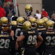 Buffs football players gather before a game.