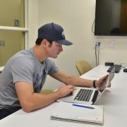 Student works on computer in Business Library