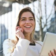 Young business woman talking on phone