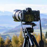Camera on tripod overlooking mountains