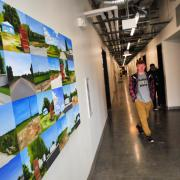 A student makes his way down a hallway in the Visual Arts Complex