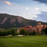 A scenic image of the Flatirons and Center For Community