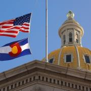 Capitol building with US and Colorado flags flying