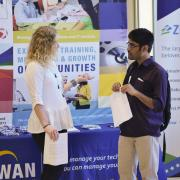 Student speaks with employer at a career fair