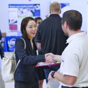 Student shakes hand with employer at career fair