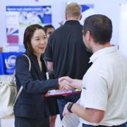 Student shakes hands with employer at last year's Just in Time Career Fair