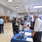 Student engages with employer at campus career fair