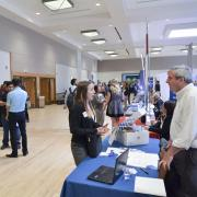 Student speaks with employer at the Career Fair