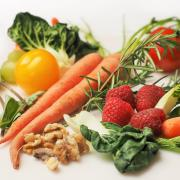 Spread of carrots, tomatoes, greens, walnuts and raspberries
