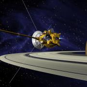The Cassini spacecraft next to Saturn