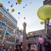 Students release biodegradable balloons as part of class project