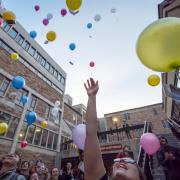 Balloons float