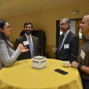 Faculty members mingle at the inaugural Faculty Awards Celebration.