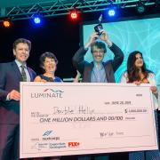 Double Helix group poses for photo with giant million-dollar check