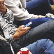 People sitting and checking mobile phones