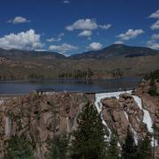 Cheesman Dam spills water down its spillway, a 220-foot high wall of boulders, in June 2019. Photo: Denver Water.