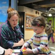 CU Boulder psychology student works with families at the Children's Museum in Denver last spring thanks to Outreach Award.