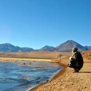 Student squats by the water in Chile; photo by Kristina Lu