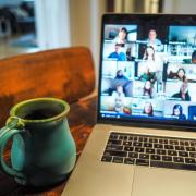 video conference call with coffee cup