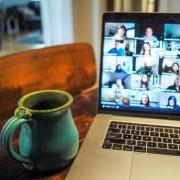 Zoom meeting with a coffee mug