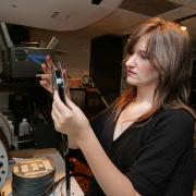 student prepares for film screening