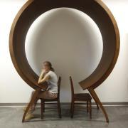 Woman sits unique circle table