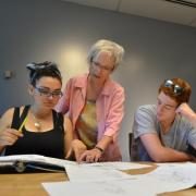 Instructor helping students