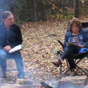 Professor Clint Carroll sits around fire with with the Cherokee Nation Medicine Keepers