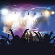 Audience members dancing at show