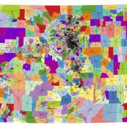 Graphic that pinpoints the hundreds of voting districts in the state, then connects them with lines to form borders.
