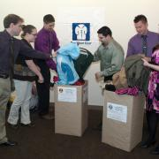 Employees donate coats during coat drive
