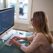 Female programmer writing code