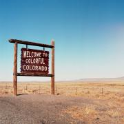 The 'welcome to colorful colorado' sign stands along a Colorado highway.