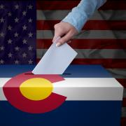 Ballot box with Colorado and U.S. flag stock image