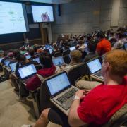 Students with laptops open in classroom