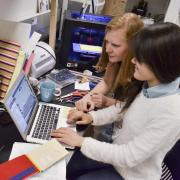 Students work at laptop computer