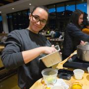 Students participate in a cooking class