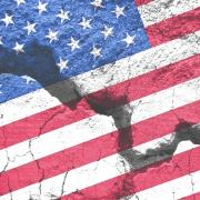 American flag graphic over cracked cement