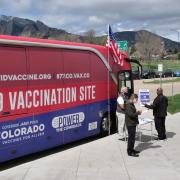 A mobile COVID-19 vaccination bus parks at the Williams Village residence complex at CU Boulder