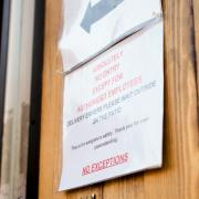 A sign on a business in Denver restricts entry to anyone but authorized employees.