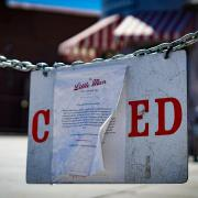 A sign announces the closure of an ice cream shop in Denver at the height of the coronavirus pandemic.