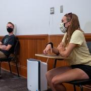 students physically distance and wear masks during class