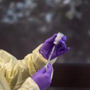 A nurse administers a vaccine