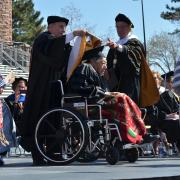 Gerald One Feather receives his honorary degree during the 2013 spring commencement. (Photo by Casey A. Cass/University of Colorado)