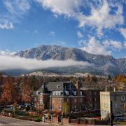 CU Boulder campus with fog and Flatirons in background