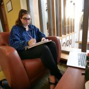Student studying in a CU dormitory lounge